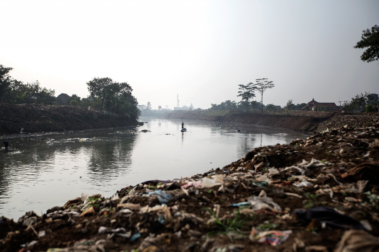Dayeuhkolot Sub-District, Bandung Regency, Indonesia, West Jawa, 2019 - The Citarum River is about 200 miles long and it is a key source for the textile factories, for hydroelectric power, for irrigate the fields, for personal hygiene and as drinking water.