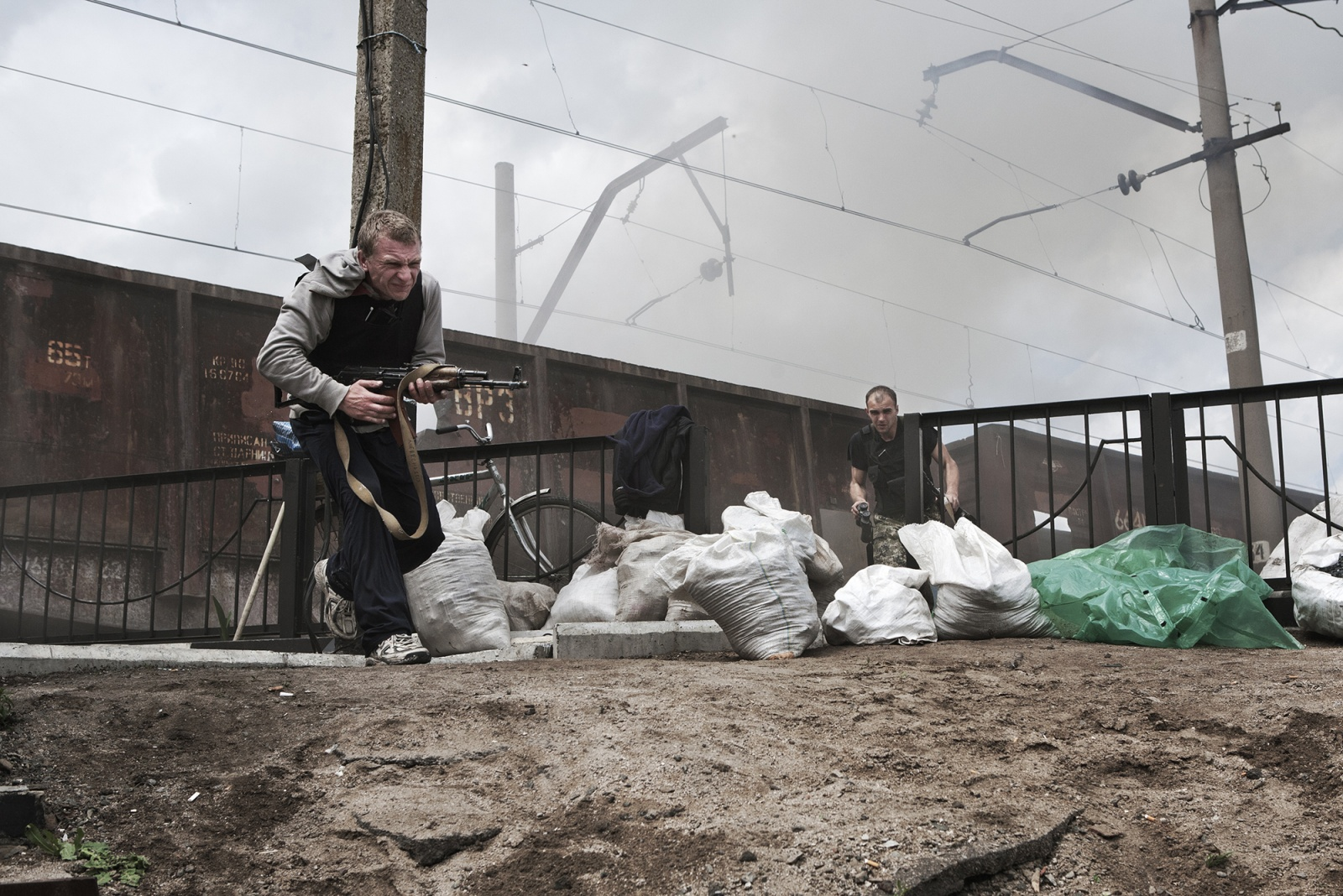 Slavyansk, Andriivka village, Ukraine. May 2014 - A bomb fired by the regular Ukrainian hits a train used by pro-Russian militants as barricade, near a small village just outside Sloviansk.The checkpoint, now recaptured and under the control of the Ukrainian troops, is located near to Karachun Mount, stronghold of the regular army.